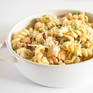A rich and creamy pasta loaded with Parmesan cheese, chicken, and bell peppers, as easy as it is delicious. You don't want to miss this one! Recipe includes nutritional information, small-yield, make-ahead, and freezer instructions. From BakingMischief.com