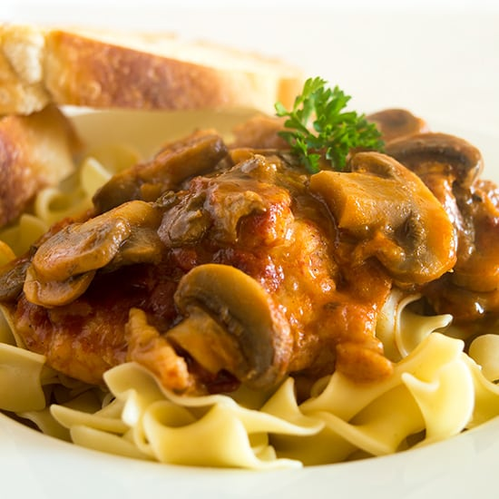 This Easy Chicken Cacciatore is boneless, skinless chicken thighs and mushrooms simmered in a rich tomato sauce and served over a bed of egg noodles for a fabulous weeknight meal. From BakingMischief.com