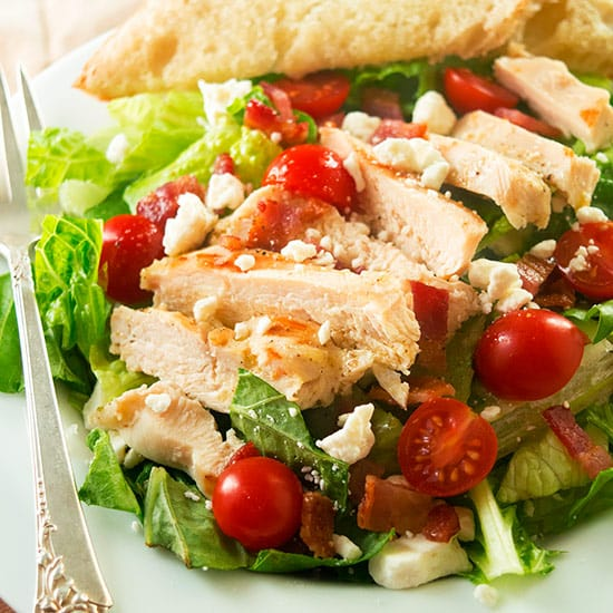 My favorite hearty chicken salad, loaded with garlic chicken, tomatoes ...