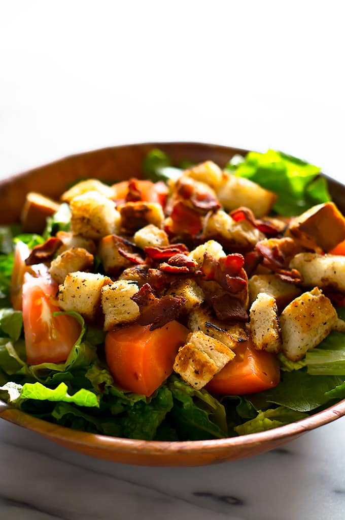 This Light and Healthy BLT Salad is a delicious twist on a favorite diner classic. From BakingMischief.com