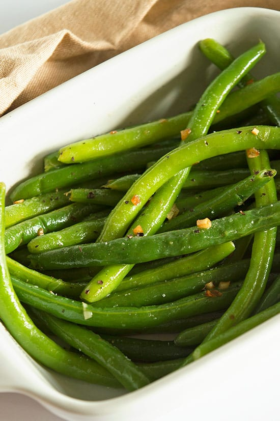 cooked green beans tossed with butter and toasted garlic. A quick ...