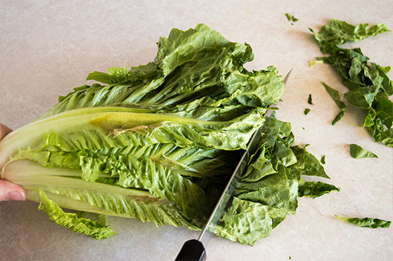 How to cut romaine lettuce for salads the fastest and easiest way possible. From BakingMischief.com