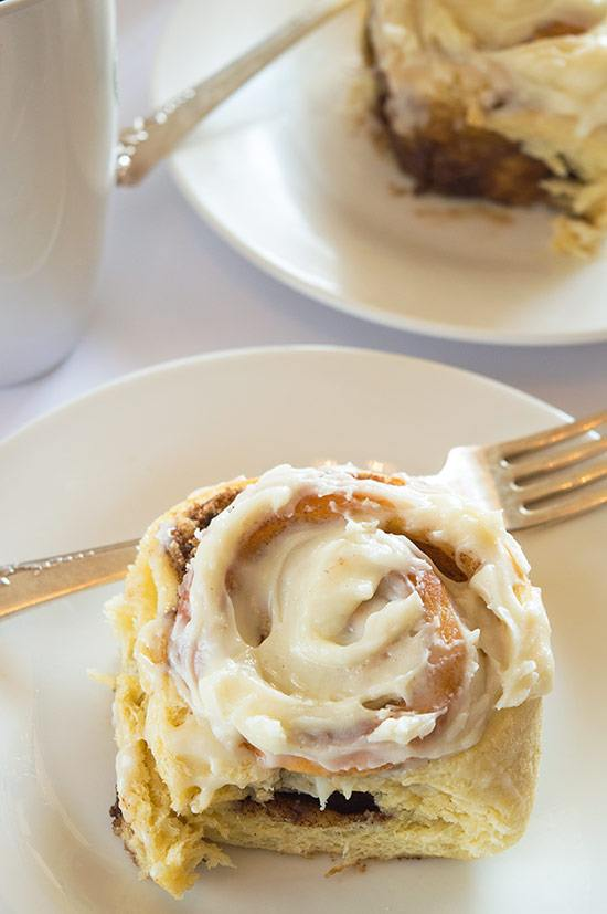 Easy Overnight Cinnamon Rolls for Two are an indulgent breakfast with outrageous cream cheese frosting. From BakingMischief.com