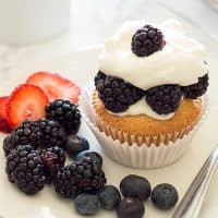 Pound Cake Cupcakes are a perfect excuse to eat cupcakes for breakfast. Light, buttery pound cake topped with the berries of your choice and smothered in a lot more than a dollop of homemade whipped cream.
