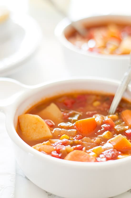This vegan vegetable stew is made with potatoes, corn, carrots, and celery simmered in a slightly spicy, tangy tomato base. A flavor-packed, low-calorie dinner that just happens to be vegan. Recipe includes nutritional information, low-yield and make-ahead instructions. From BakingMischief.com