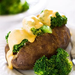 Slow Cooker Baked Potatoes With Broccoli and Cheese Sauce