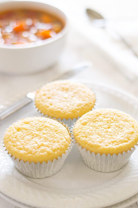 Corn bread muffins on a white plate.
