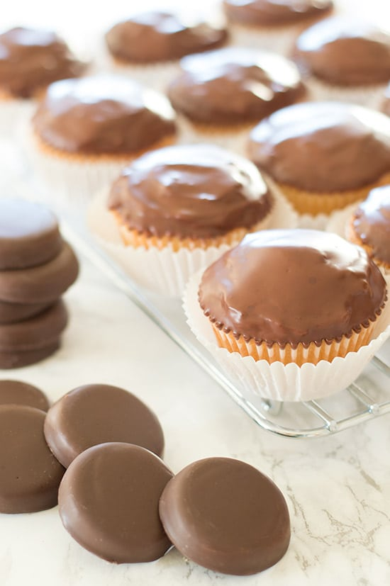 Tagalong Cupcakes are pound cake covered in peanut butter buttercream and dipped in chocolate. A perfect cupcake version of the Girl Scouts' best cookie. From BakingMischief.com
