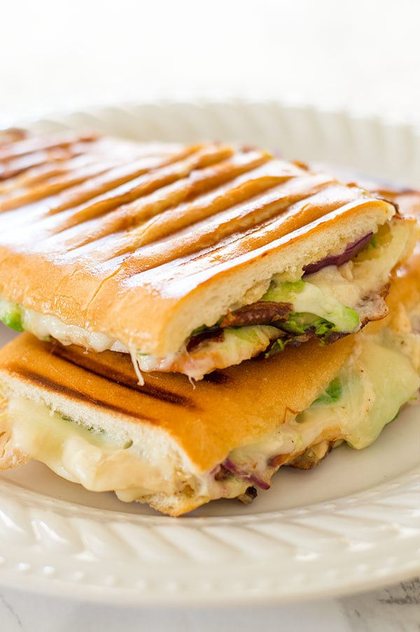 My favorite quick weeknight panini with chipotle aioli, crunchy red onions, sliced turkey, melty cheese, and avocado. Recipe includes nutritional information. From BakingMischief.com
