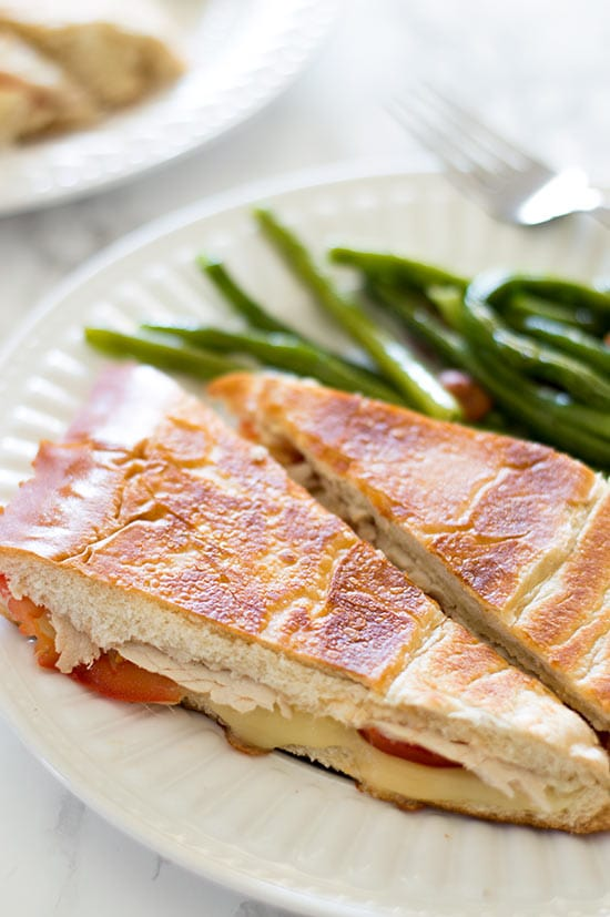 Perfectly cooked panini, crunchy and toasted on the outside, warm, gooey, and cheesy on the inside, all without using a panini press! Recipe includes nutritional information. From BakingMischief.com