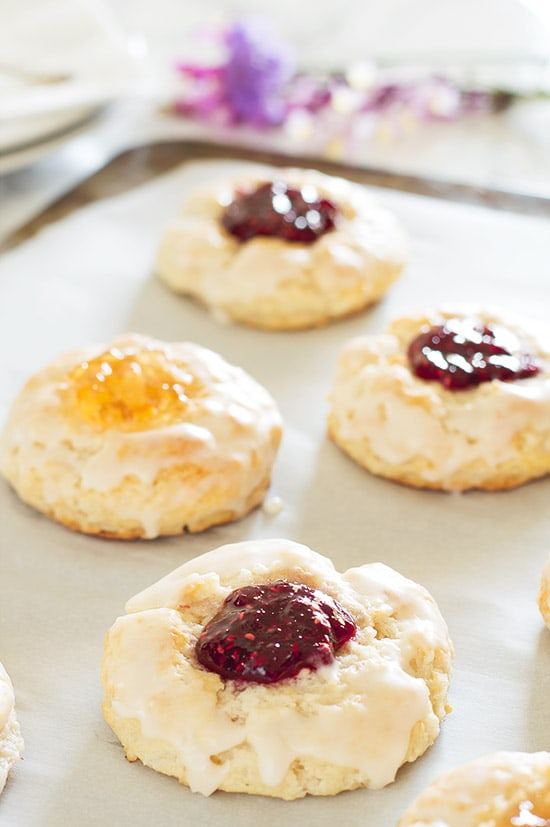 Adorable buttermilk jam scones baked with your favorite jam inside and brushed with a buttery vanilla glaze.