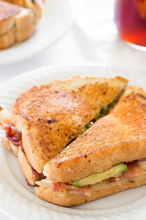 A grown up grilled cheese sandwich loaded with bacon, avocado, chicken, and pepper jack cheese. Recipe includes nutritional information. From BakingMischief.com