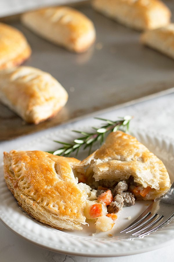 Buttery, flaky buttermilk pie crust wrapped around a savory mixture of steak, carrots, potatoes, and onions. These hand pies are surprisingly easy and one of my favorite recipes to ever come out of my kitchen! Recipe includes nutritional information and freezer instructions. From BakingMischief.com