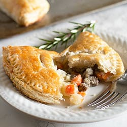 Buttery, flaky buttermilk pie crust wrapped around a savory mixture of steak, carrots, potatoes, and onions. This is one of my favorite recipes to ever come out of my kitchen! Recipe includes nutritional information and freezer instructions.