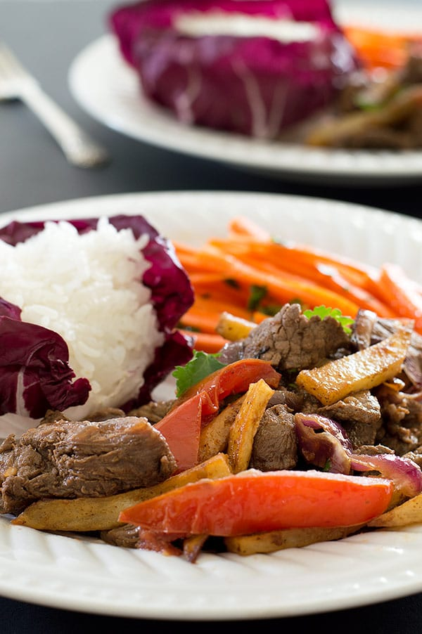 Lomo Saltado on a white plate.
