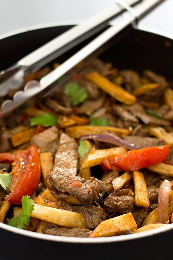 Lomo Saltado is tender stir-fried beef sirloin, red onions, and tomatoes served with baked french fries and white rice. Carb lovers, you have to try this one!