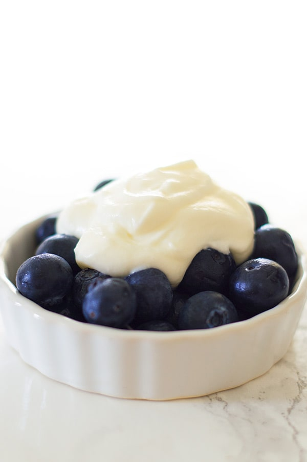 This small batch of light and tangy cream cheese whipped cream is quick and easy to make. Serve over fruit for a light dessert or pile high over baked goods for something truly decadent. Recipe includes nutritional information. From BakingMischief.com