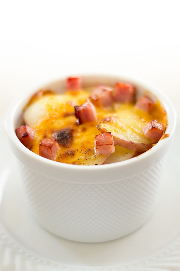 These scalloped potatoes for one are a shortcut version of one of my favorite comfort foods! Layers of bubbly cheddar cheese, ham, and pre-cooked potatoes in a perfect, quick-cooking, portion-controlled serving. Recipe includes nutritional information. From BakingMischief.com