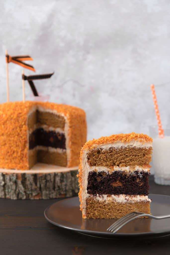 Photo of chocolate pumpkin oreo cake slice.