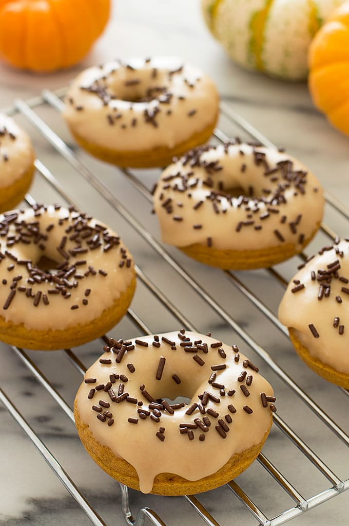 These Pumpkin Donuts with Maple Glaze are moist, lightly spiced, and delicious. Recipe includes nutritional information. From BakingMischief.com