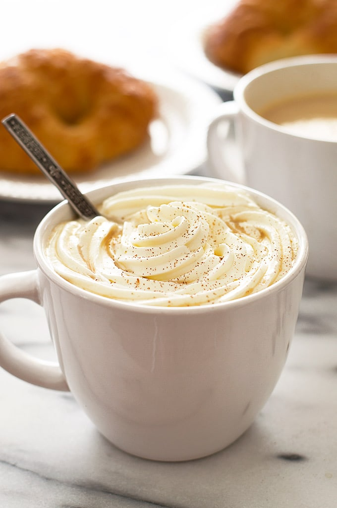 Pumpkin spice latte recipe with whipped cream.