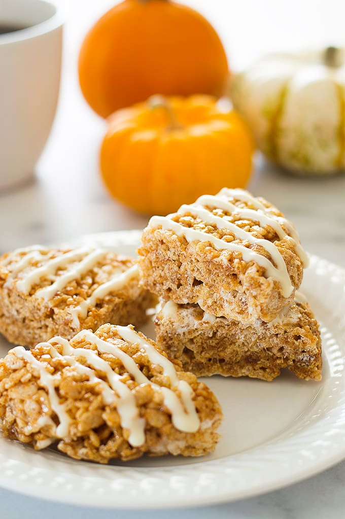 Pumpkin Spice Rice Krispie Treats stacked on a plate.