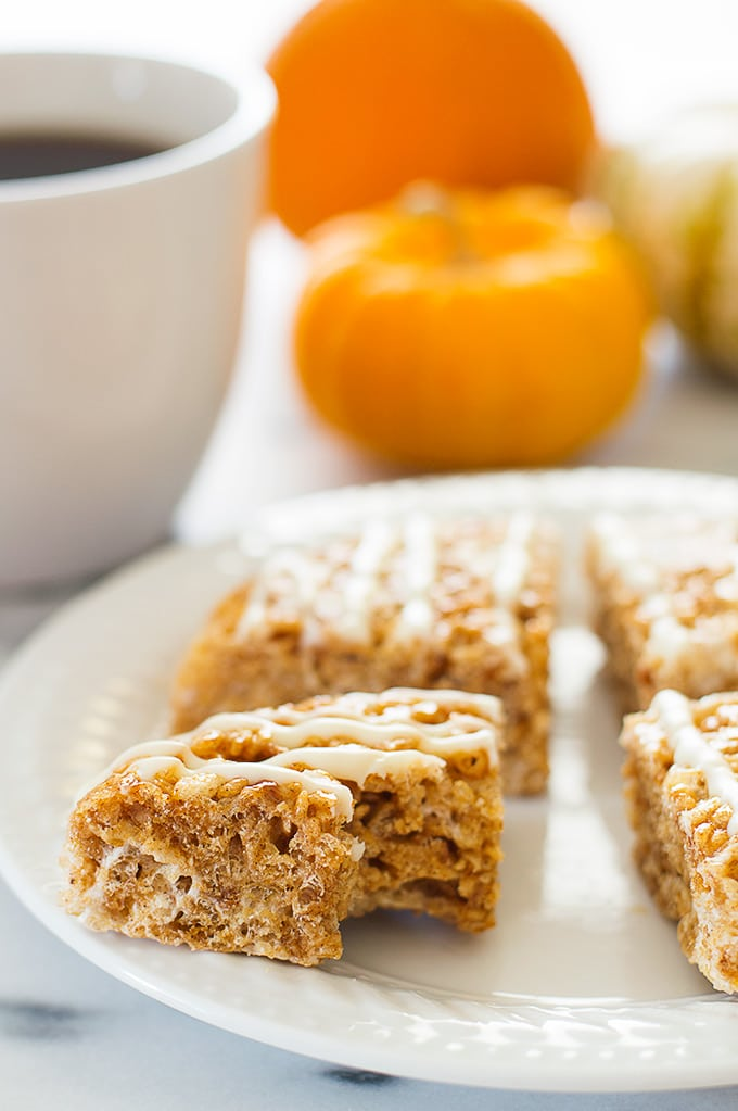 Pumpkin Spice Rice Krispie Treats with a bite taken out of it.