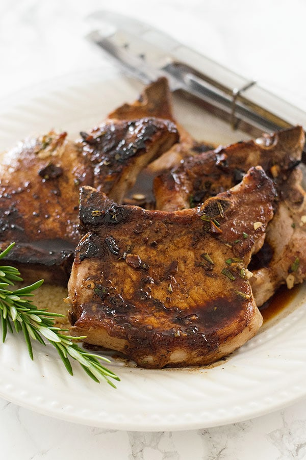 Rosemary pork chops on a plate.