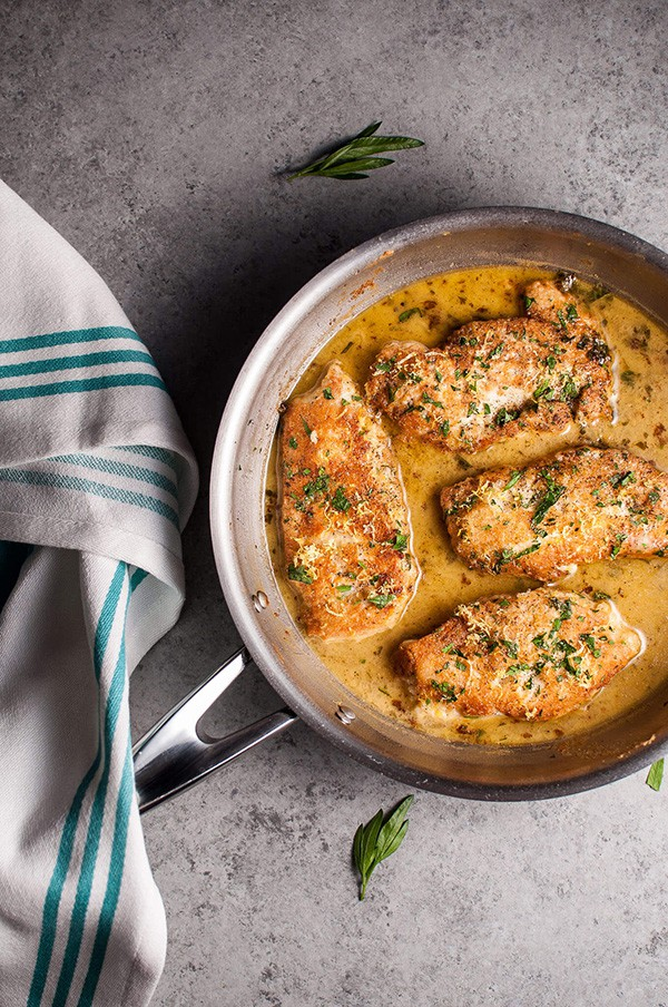 Chicken Francese in a pan.