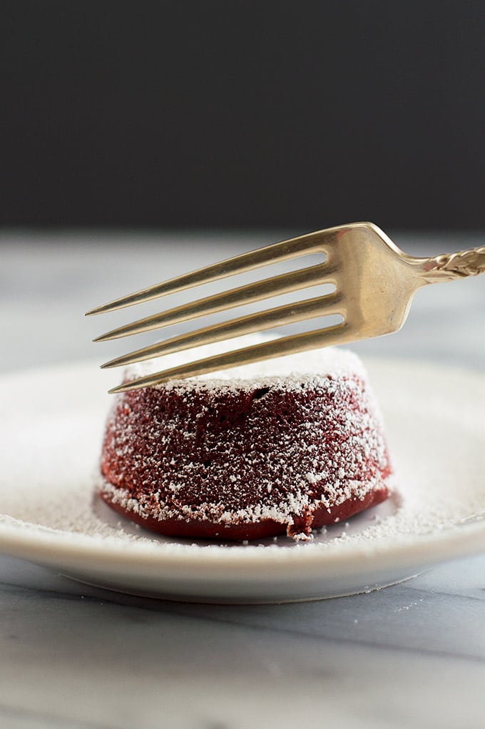 Red velvet lava cake being sliced into.