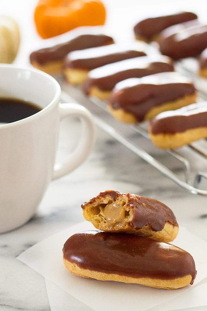 Pumpkin eclairs and a cup of coffee.