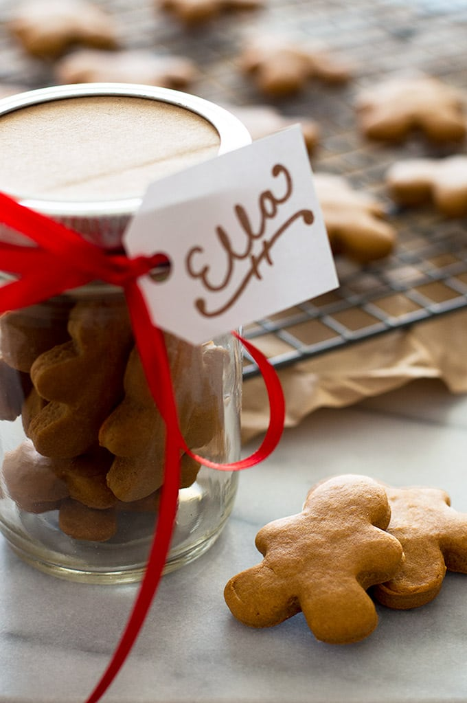 Horse and dog gingerbread treats in a glass jar for gifting.