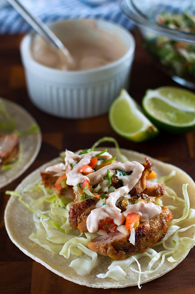 Chipotle Chicken Tacos with Yogurt Sauce make a fabulous easy dinner. From BakingMischief.com
