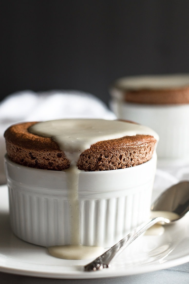 Chocolate Souffles for Two with Creme Anglaise are a perfect make ahead date night dessert. From BakingMischief.com