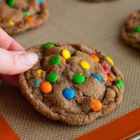 This Small-batch Chocolate Mini M&M Cookies recipe makes a half dozen perfect chocolate cookies! From BakingMischief.com