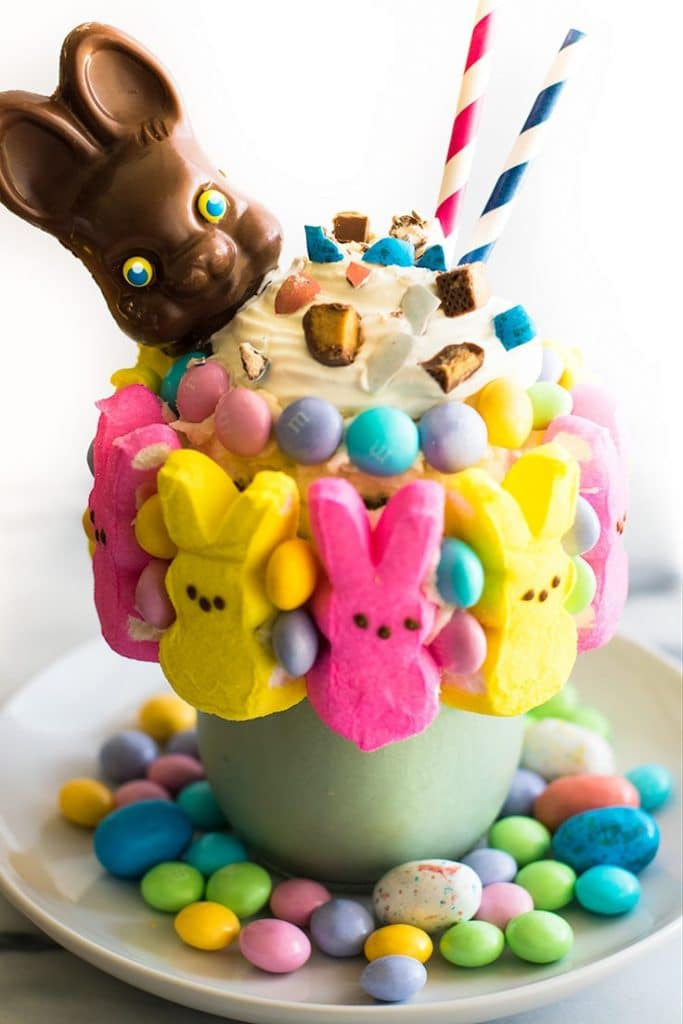 Picture of an Easter Candy Freakshake in a mason jar with a chocolate bunny head on top.