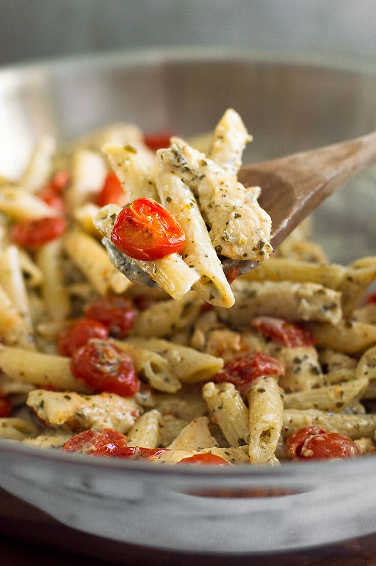Wooden spoonful of Pesto Chicken Pasta.