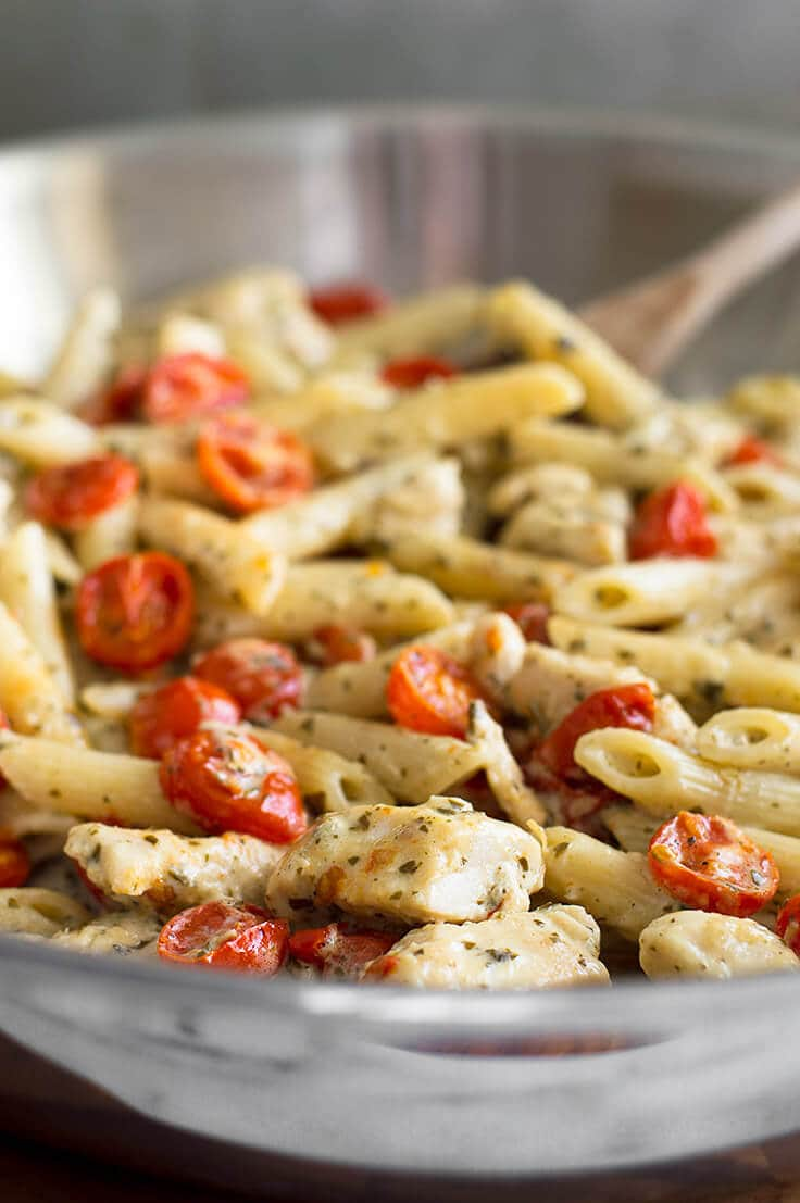 easy pesto chicken pasta for two with oven roasted tomatoes baking