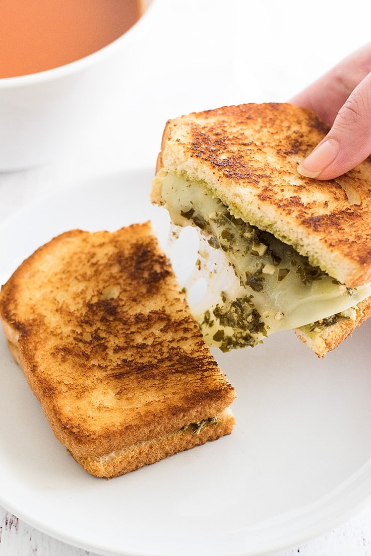 Need a lunch or dinner for one? Try this Pesto Grilled Cheese Sandwich paired with a bowl of tomato soup!