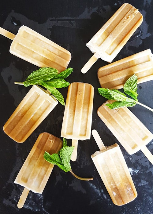 Boozy Mint Coffee Coconut Cream Popsicles from Feast in Thyme - My favorite popsicle tips and tricks plus some of the best popsicle recipes on the internet!