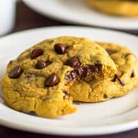 These Small-batch Chocolate Chip Pumpkin Cookies are soft and chewy with plenty of pumpkin spice flavor, like the perfect chocolate chip cookie all dressed up for fall. | #cookies | #pumpkinspice | #falldesserts |
