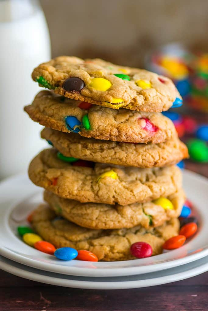 Photo of M&M cookies made with an egg yolk on a white plate.