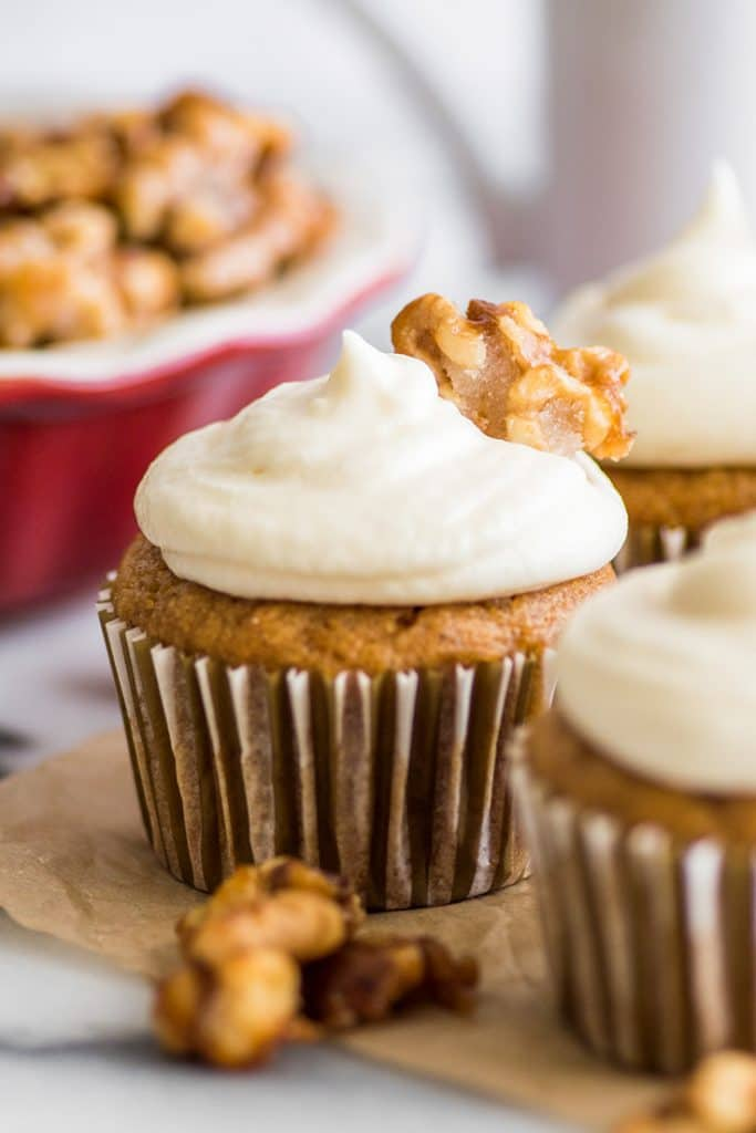 Small-batch pumpkin cupcakes with cream cheese frosting and candied walnuts.
