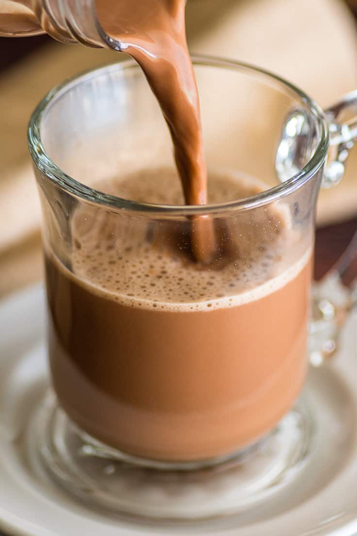 Homemade mocha being poured into a cup.
