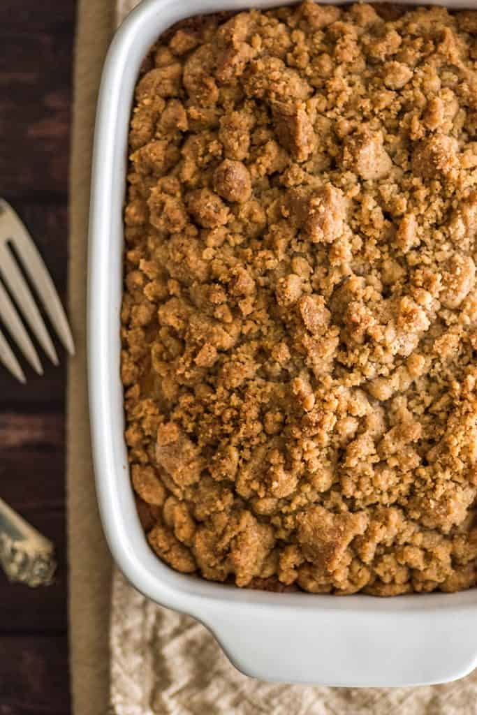 Small coffee cake with streusel in a baking dish.