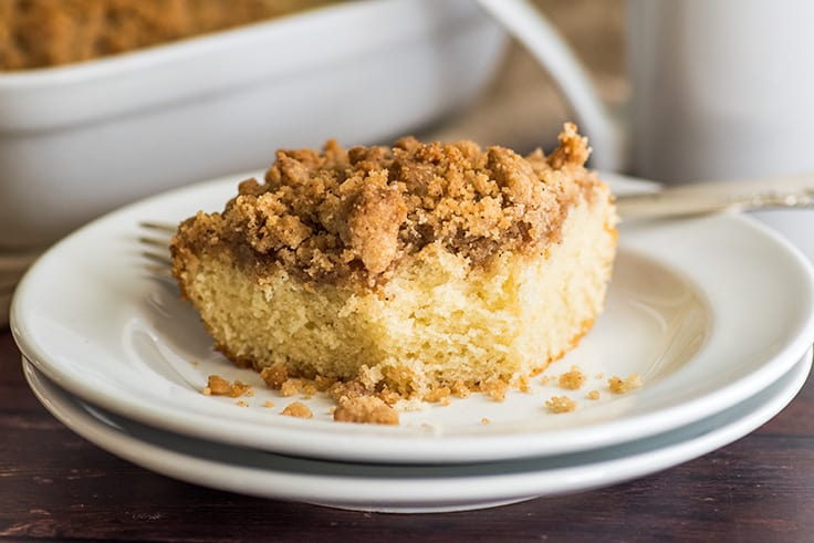 Mini coffee cake slice with a bite out of it.
