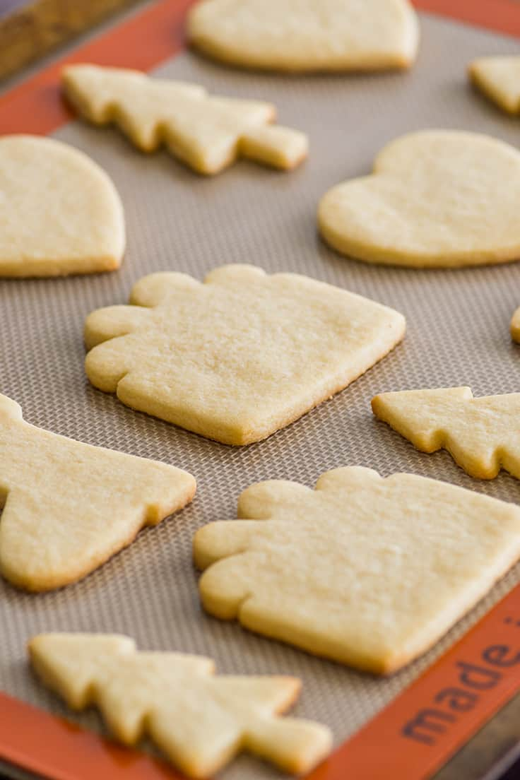 Small batch of sugar cookies cut out and baked on a baking sheet.