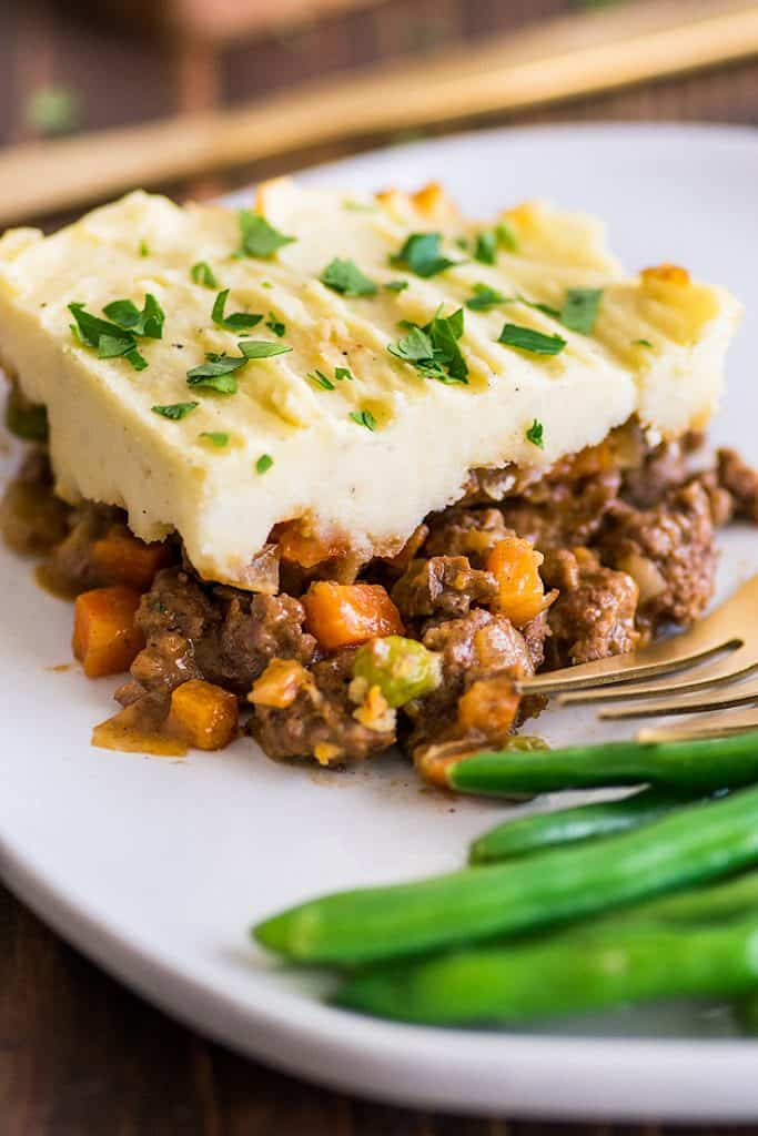 Picture of a slice of Easy Shepherd's Pie With Ground Beef on a white plate.