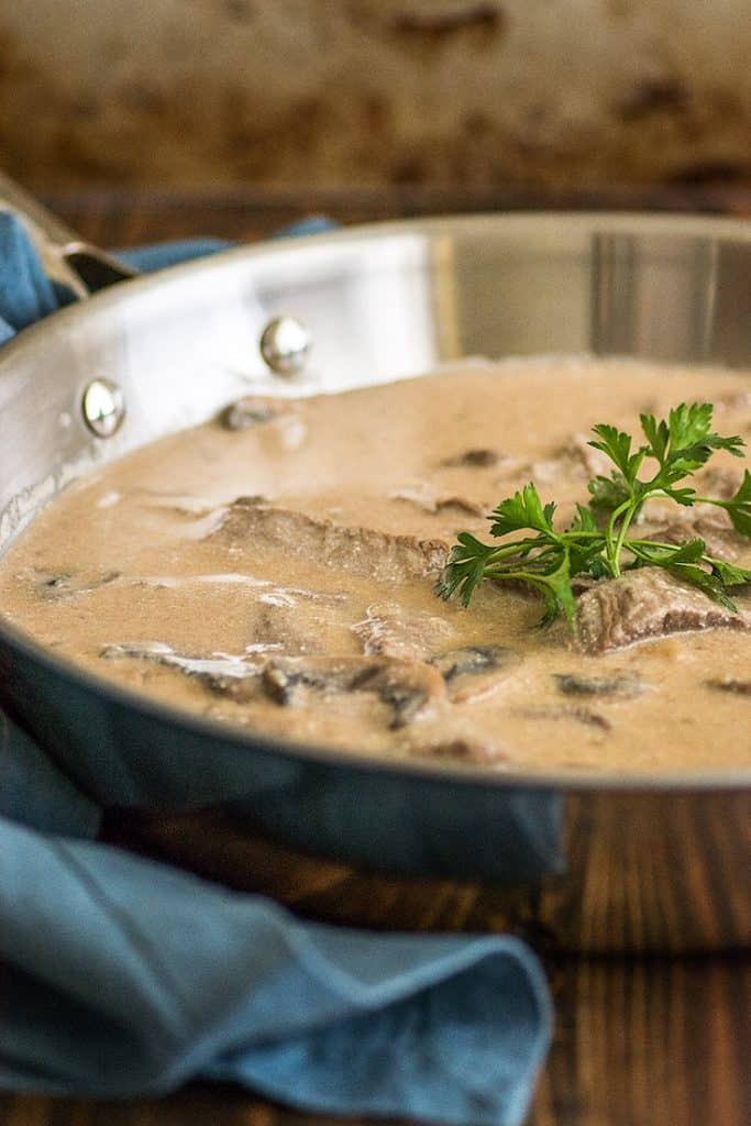 Photo of easy beef stroganoff sauce in a skillet.