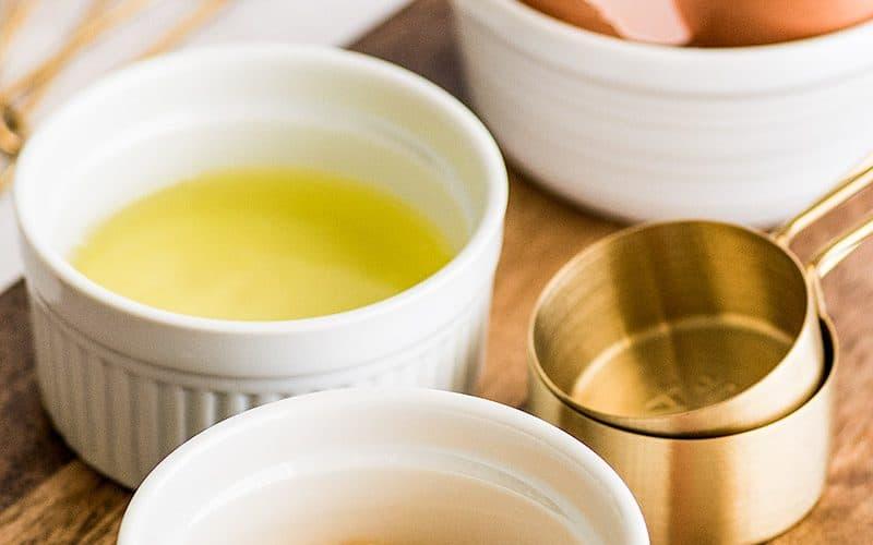 Photo of egg yolks in white ramekin to use in egg yolk recipes.